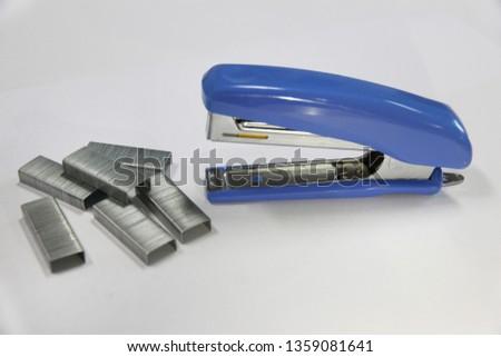Blue stapler, stapler.