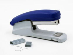 Blue stapler with staples isolated on a white background