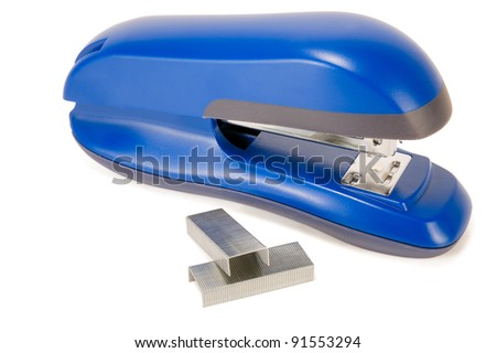 blue stapler with staples on white background