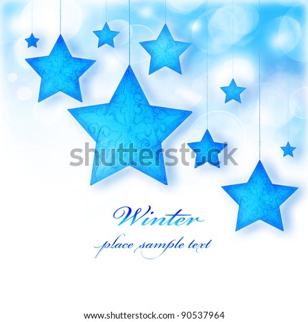 Blue stars, Christmas tree ornaments and holiday decorations, winter border with bokeh lights and white text space