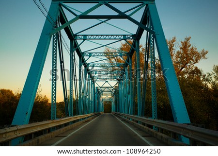 Blue steel bridge at sunset - stock photo