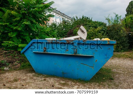 blue steel container with rubble #707599159