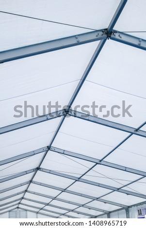 Blue Steel frame tents Background. Inside Big Canvas Tent #1408965719