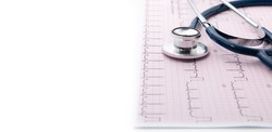 Blue Stethoscope on electrocardiogram (ECG) chart paper. ECG heart chart scan isolate on white. Healthcare insurance and medical background