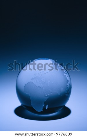 Blue still life of globe showing continents of Europe, Asia and Africa.