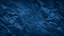 Blue stone background. Toned rock texture. Close-up. Dark blue grunge background with copy space for your design.