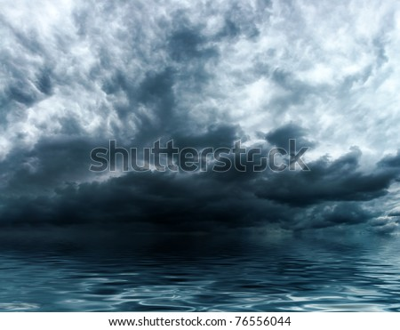 Blue storm clouds on a sky background over water surface