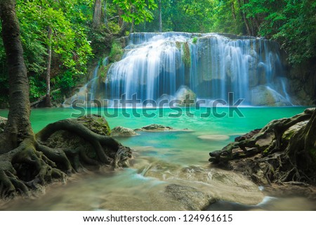 Blue stream waterfall at Erawan waterfall National Park Kanjanaburi Thailand - stock photo