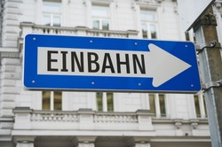 blue street sign in Vienna, Austria with the German word for