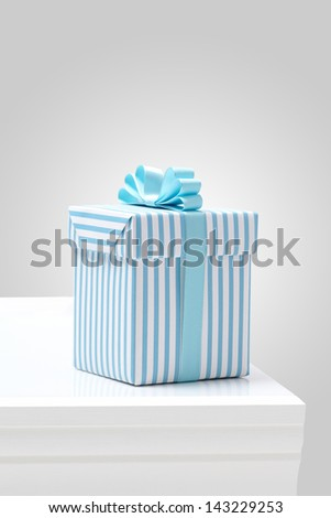 blue striped pattern gift box on white table. Gift boxes with blue ribbon.