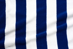Blue stripes beach towel  mock up isolated on white background, flat lay top view shot