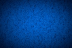 Blue structured background with vignetting, darkening around the edges of the photo