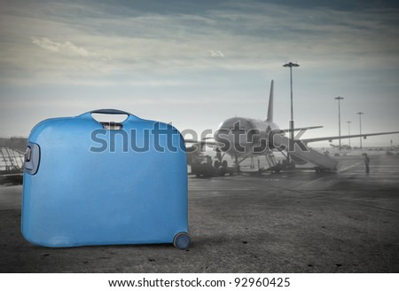 Blue suitcase in an airport