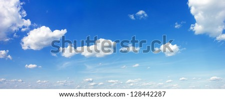 Blue summer sky with clouds background