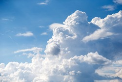 Blue summer sky with puffy clouds, peace and meditation concept