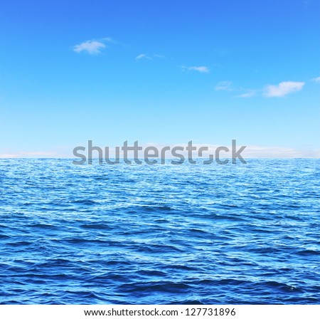 Blue sunny sea and soft sky