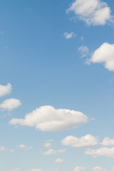 Blue Sunny sky, white Cumulus clouds lower layer of cloud cover, sky background .