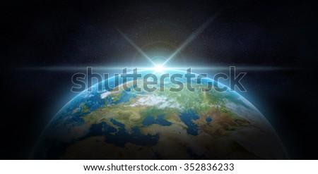 Blue sunrise, view of earth from space.The Earth texture of this image furnished by NASA.