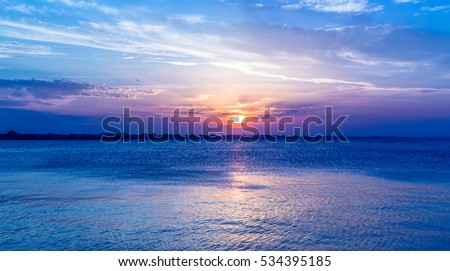 blue sunset sky over sea.intense colors. Twilight landscape. Sun at dusk. Rimini Italy #534395185