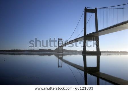Blue suspension bridge a cold winter day in Denmark. #68121883