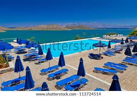 Blue swimming pool at Mirabello Bay in Greece