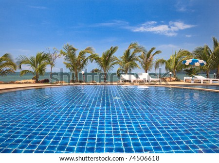 Blue Swimming Pool Water And Palm Trees Near The Sea Summer Vacations In Tropical Resort Stock