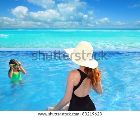 blue swimming pool with direct caribbean sea and rear mother view with goggles daughter [Photo Illustration]
