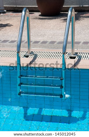 blue swimming pool with stair at sport center.