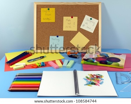 Blue table in office with colorful equipment