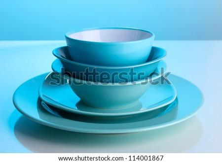 Blue tableware on blue background