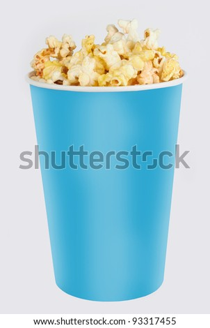 blue tall bowl with popcorn isolated on white