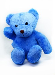 Blue teddy bear against a white background