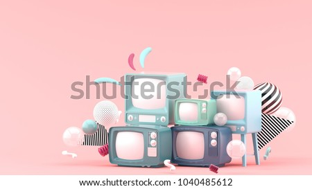 blue television among the colorful balls on the pink background.-3d render.