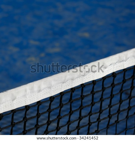 blue tennis court and net