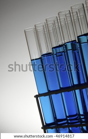 blue test tubes in a rack with white background