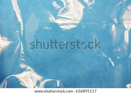 Blue texture of plastic (latex) with reflections and bubbles, similar to the sea texture. Background stock photo