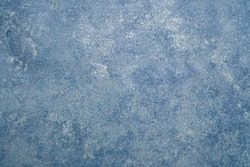 Blue texture painted on canvas.Artist blue primed cotton mottled grunge background