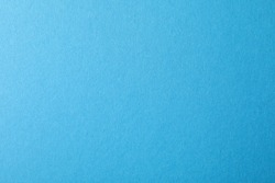 Blue textured sheet background. Empty space for text