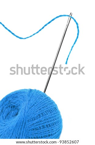 Blue thread ball and needle with pink thread isolated on white
