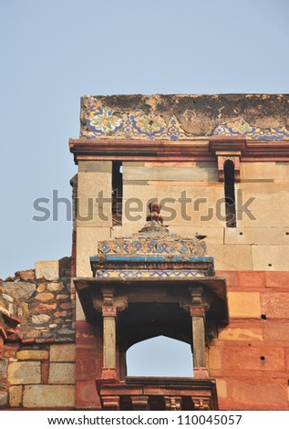 "Blue Tile Decorations on a Chatri over Main Gate at ""Purana Qila"" or Old Fort Delhi India. The chatri is derived from Hindu architecture and is common in Indian Islamic design."