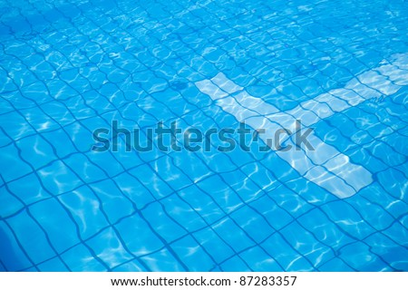blue tiles swimming pool water