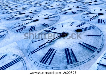 Blue tinted clock faces. - stock photo