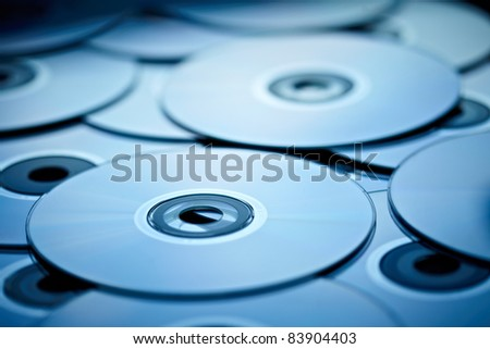 blue tinted close-up of a stack of cd-roms
