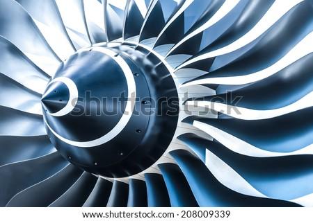 blue tone jet engine blades closeup