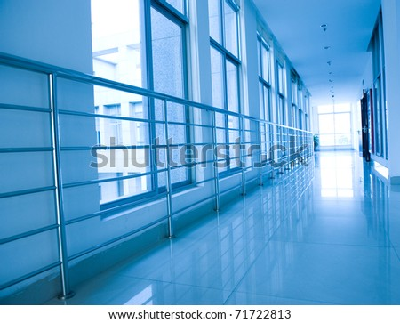 blue tone of long corridor in hospital.