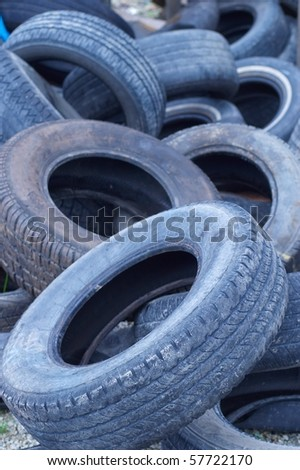 Blue tone pile of old tires