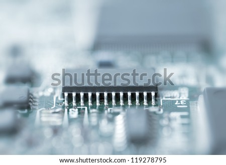 Blue toned close up microchip shot with shallow depth of field - stock photo