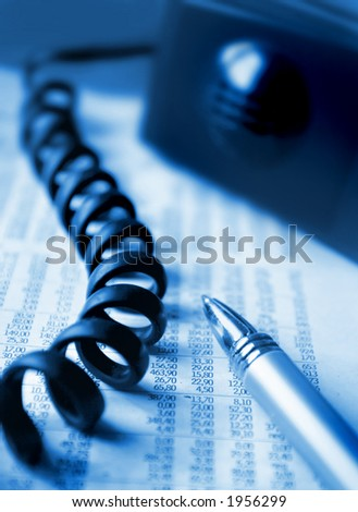 Blue toned image of a financial report and a phone
