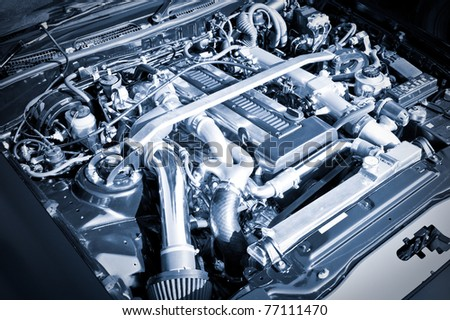 blue toned performance sports car engine bay - stock photo