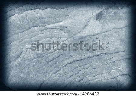 Blue toned stone background with darkened borders.